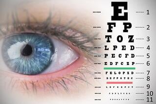 Close up of female blue eye against eye test.jpeg