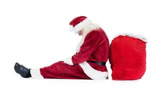 Santa sits leaned on his bag on white background and sleeps.jpeg