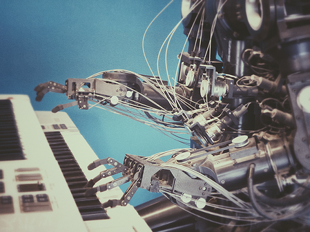 Robot playing keyboard - image from Unsplash